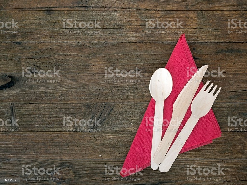 Disposable eco-friendly wooden cutlery and re serviette stock photo