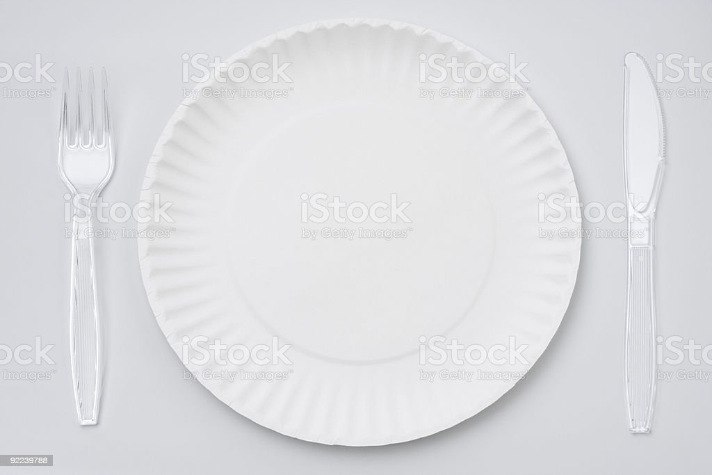 Disposable paper plate and cutlery stock photo