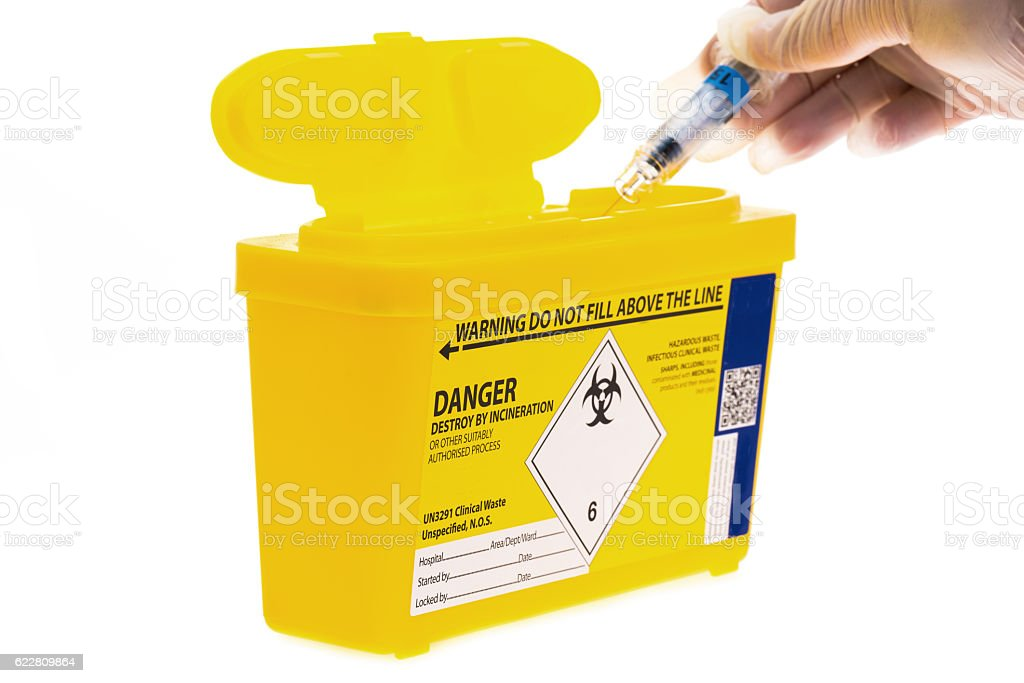 Disposable sharps waste container stock photo