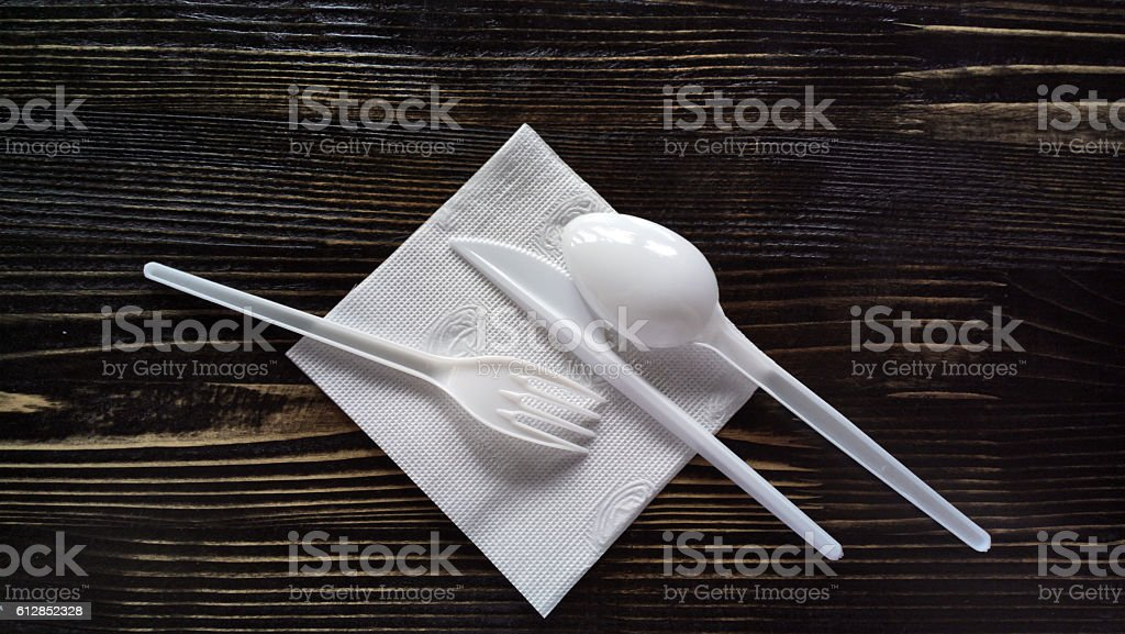 Disposable tableware on a wooden surface. stock photo