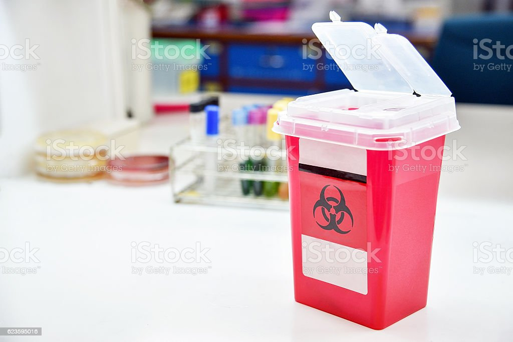 Disposal container; reducing medical waste disposal. stock photo