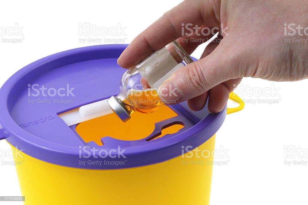 Disposal in a Sharps Bin royalty-free stock photo