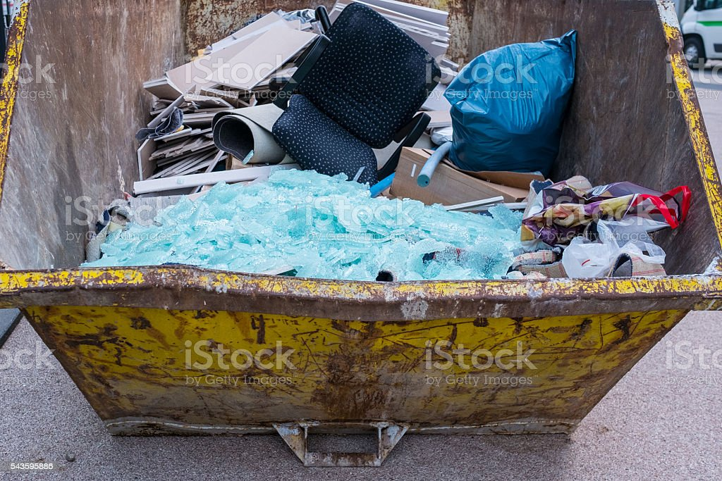 Disposal of waste in a container stock photo