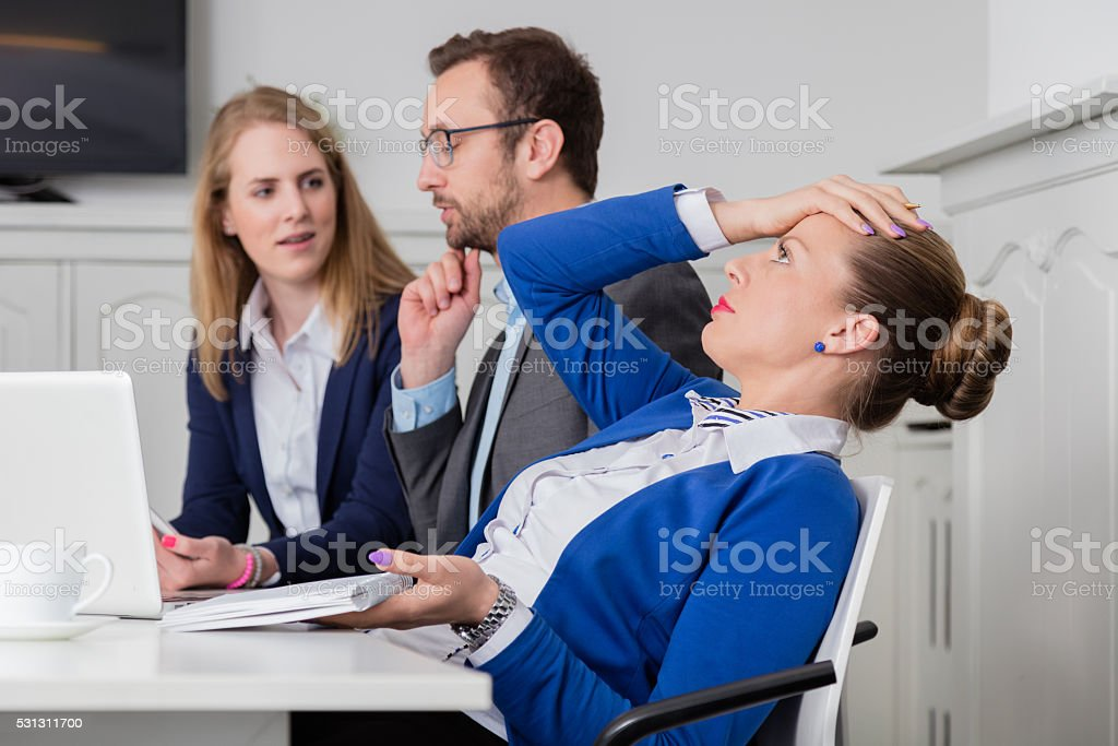 Dissatisfied businesswoman on a meeting stock photo