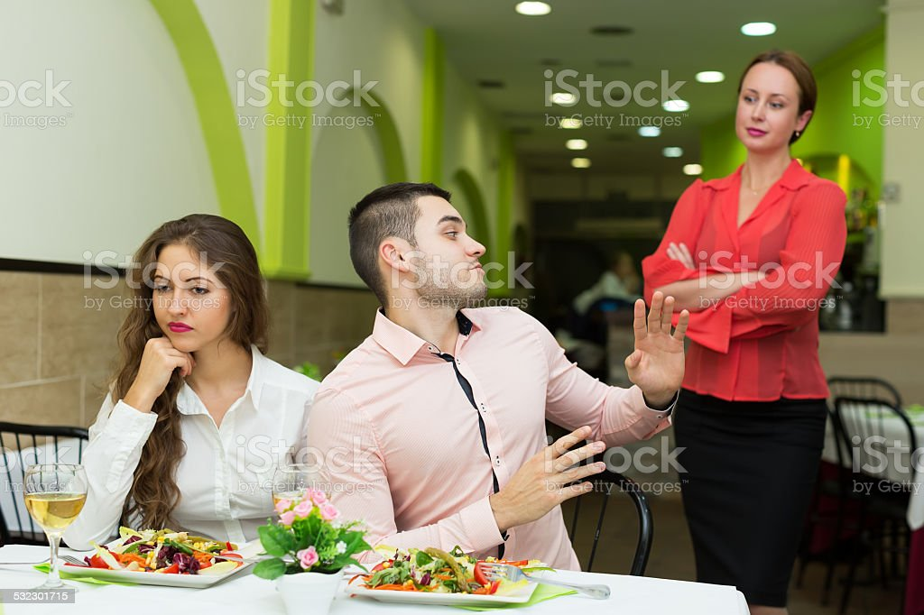 Dissatisfied visitors in restaurant stock photo