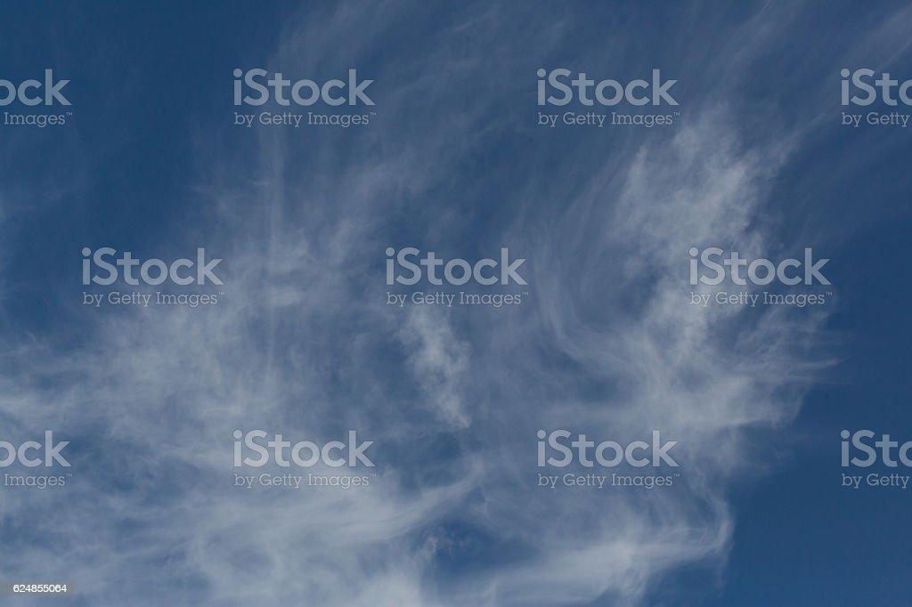 Dissolving cirrus clouds stock photo