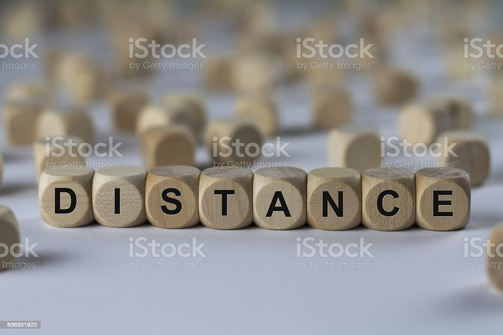 distance - cube with letters, sign with wooden cubes stock photo