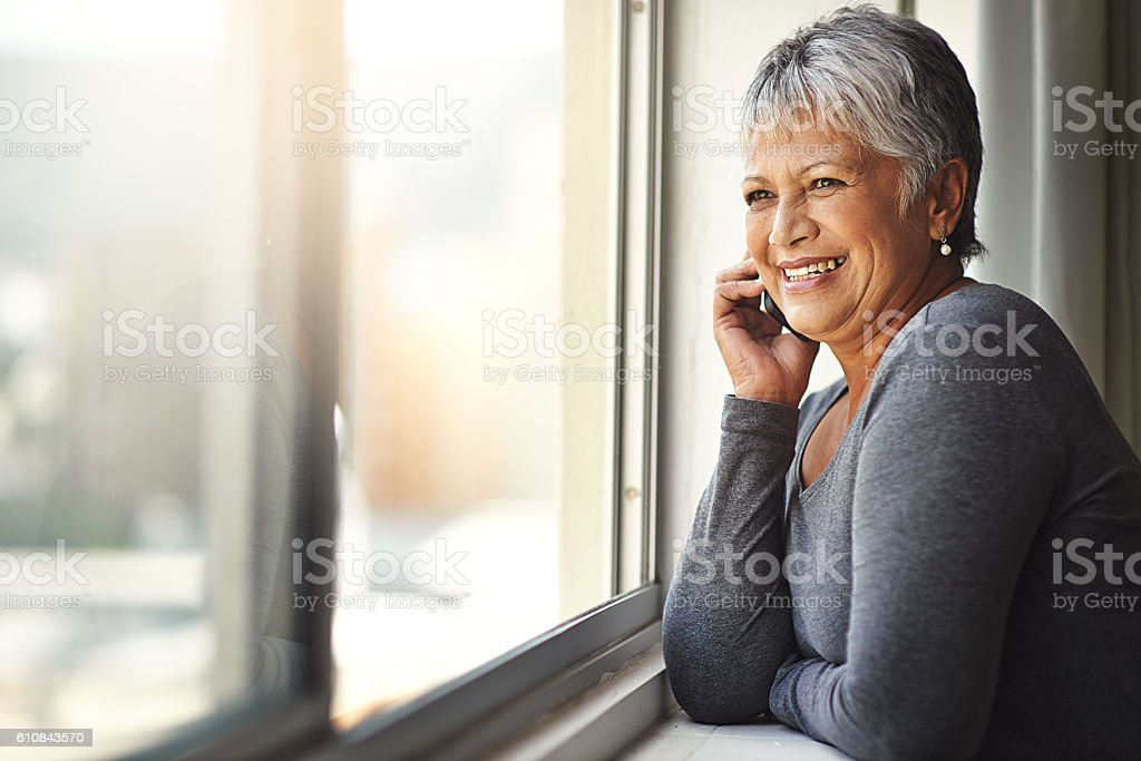 Distance is no match for her phone's connectivity stock photo