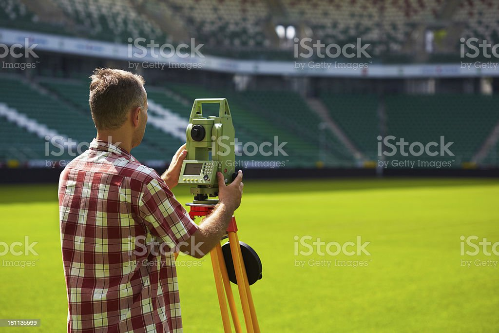 Distance measuring with total station royalty-free stock photo
