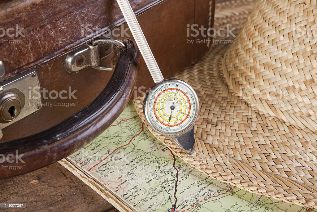 Distance meter and suitcase stock photo