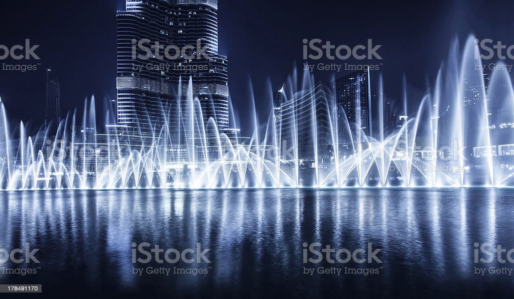 A distance night photograph of a fountain in Dubai stock photo