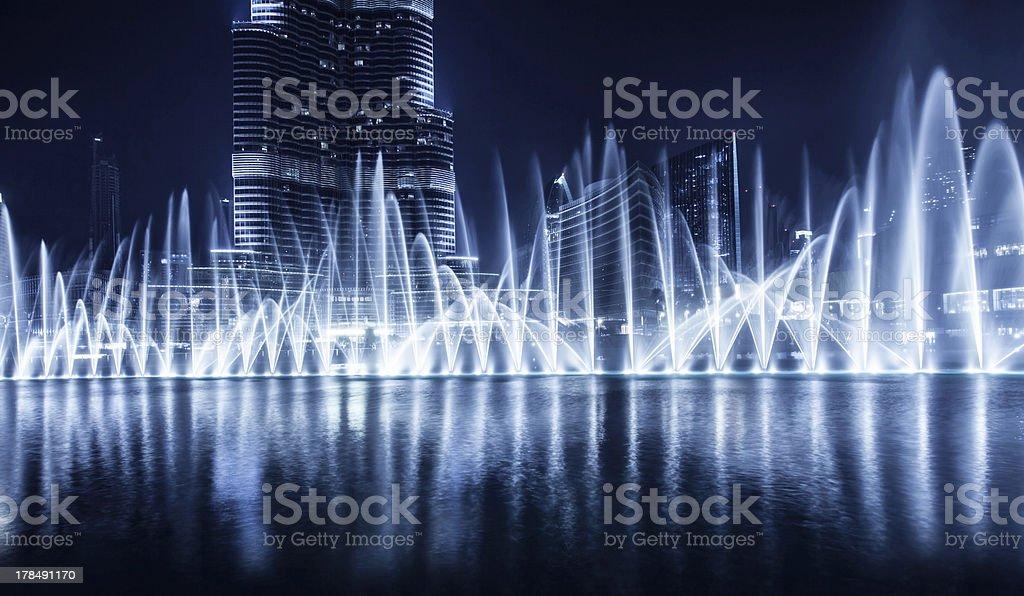A distance night photograph of a fountain in Dubai stock photo