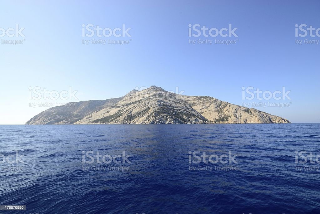 A distance shot of Monte Cristo from the water royalty-free stock photo
