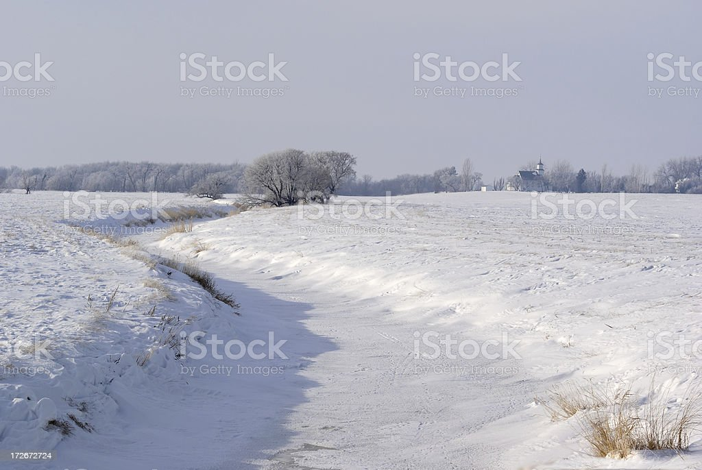 distant church on winter landscape royalty-free stock photo