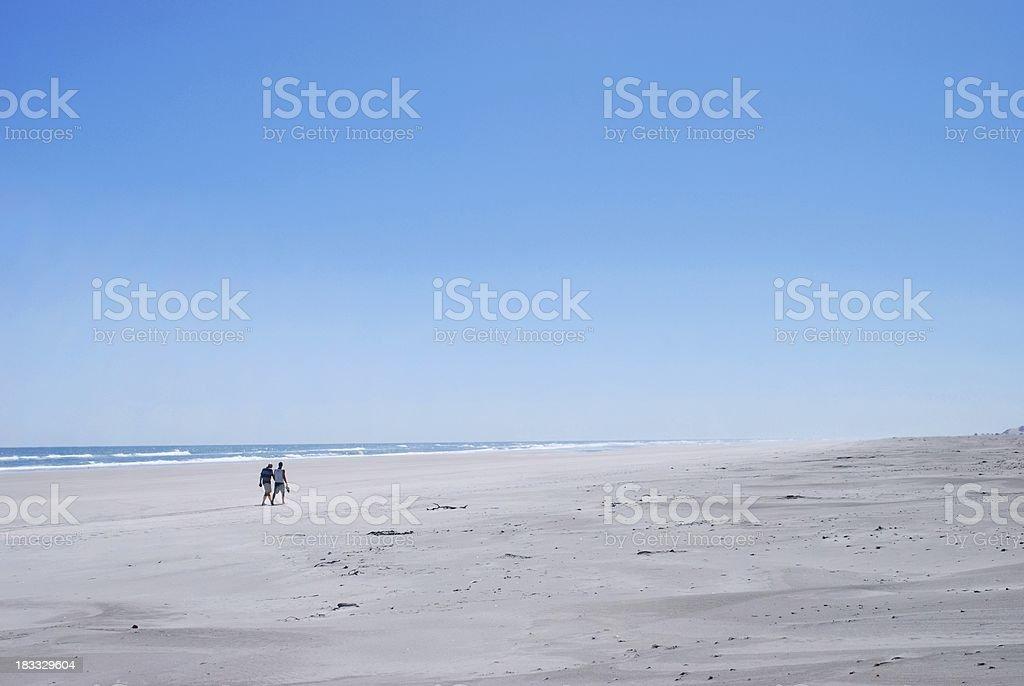 Distant Figures on Beach stock photo