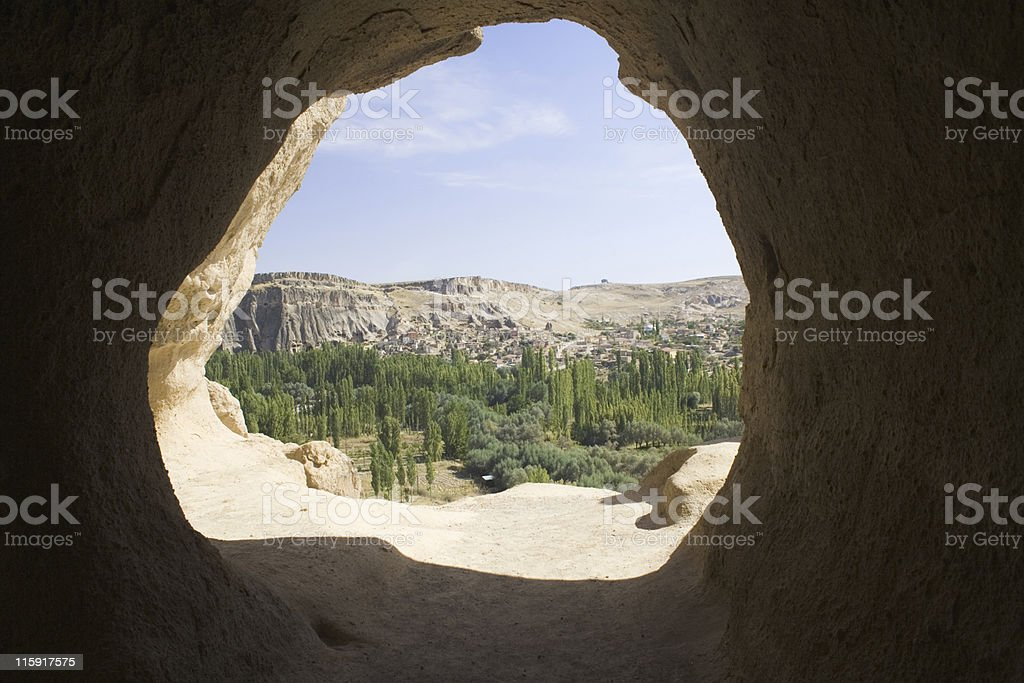 Distant Goreme seen through cave opening royalty-free stock photo