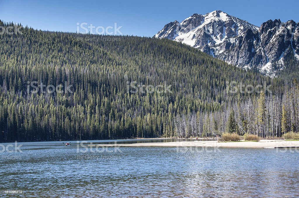 Distant Kayakers on mountain lake royalty-free stock photo