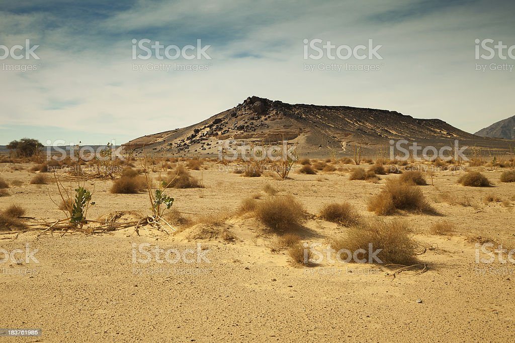 Distant mountain in Libyan Sahara desert stock photo
