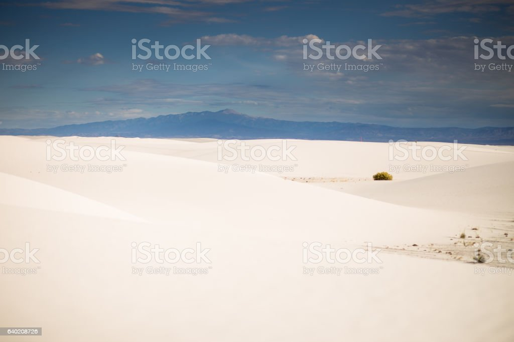 Distant Mountains Beyond White Sands stock photo