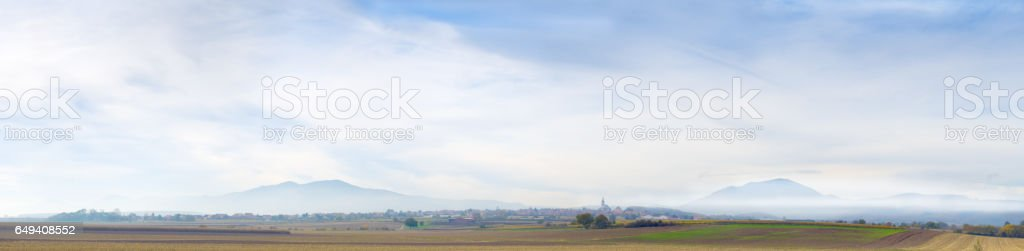 Distant mountains in mist in Alsace. stock photo