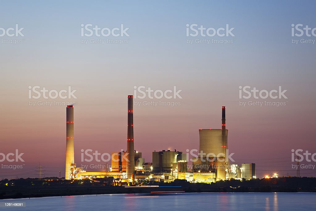 Distant Power Plant At Sunset stock photo