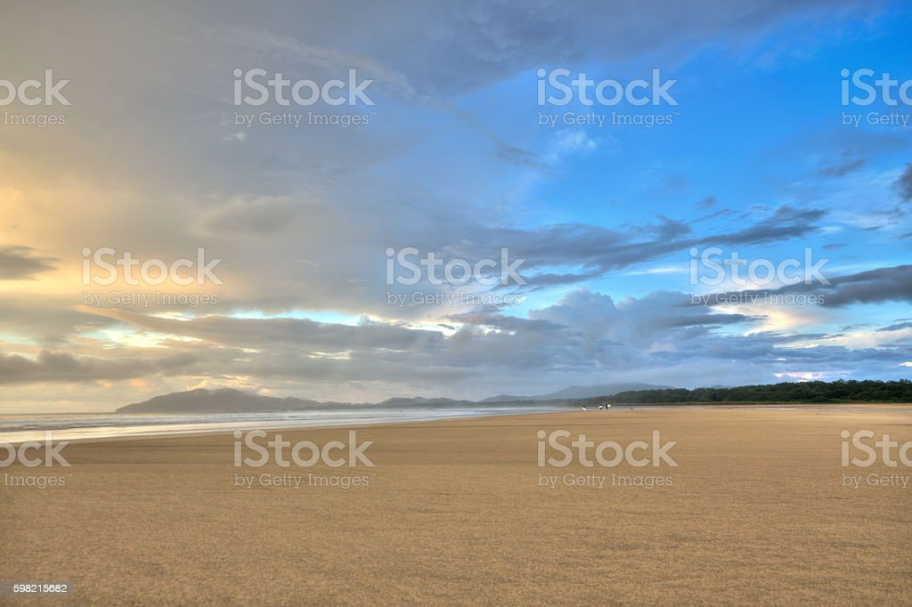 Distant Returning Surfers stock photo