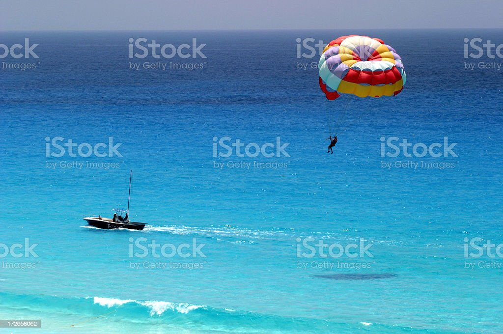 Distant shot of parasailing over ocean royalty-free stock photo