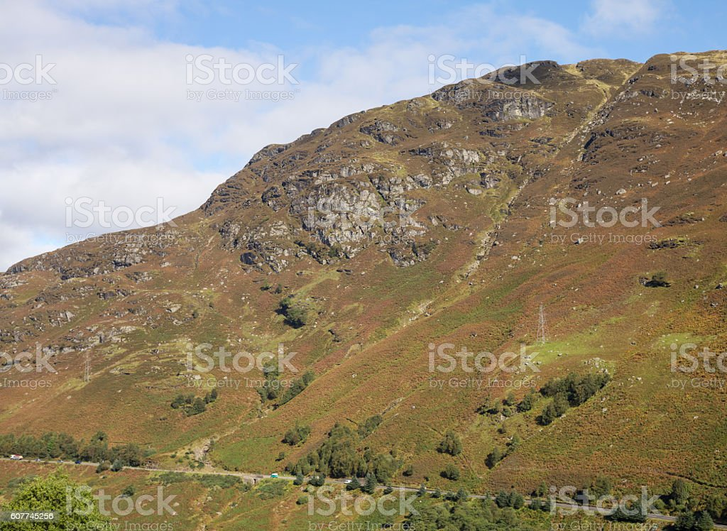 Distant traffic on the A85 through the Trossachs in Scotland stock photo