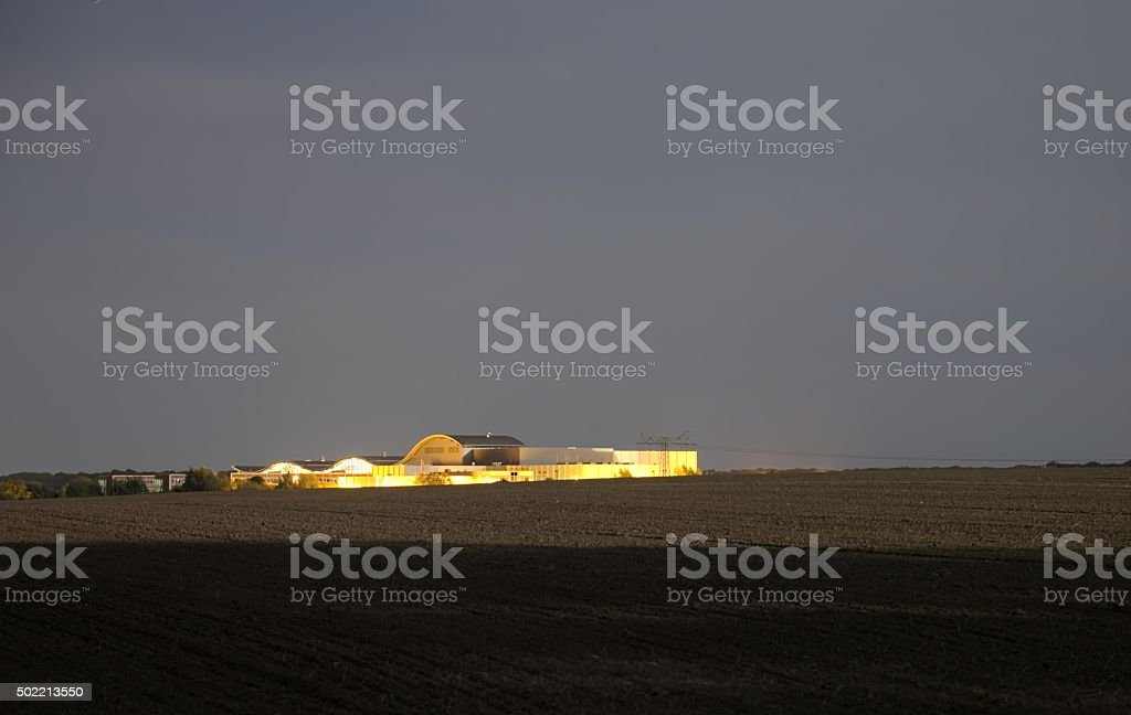 Distant View of fields and MPI In Greifswald At Night stock photo