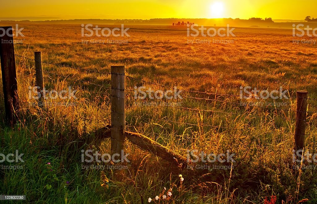 Distant View of Stonehenge with Summer Sunrise stock photo