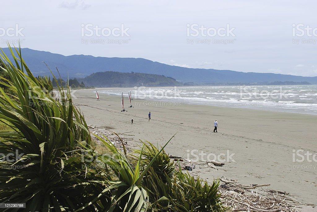 Distant Wind Buggies, Pohara Beach, Golden Bay stock photo