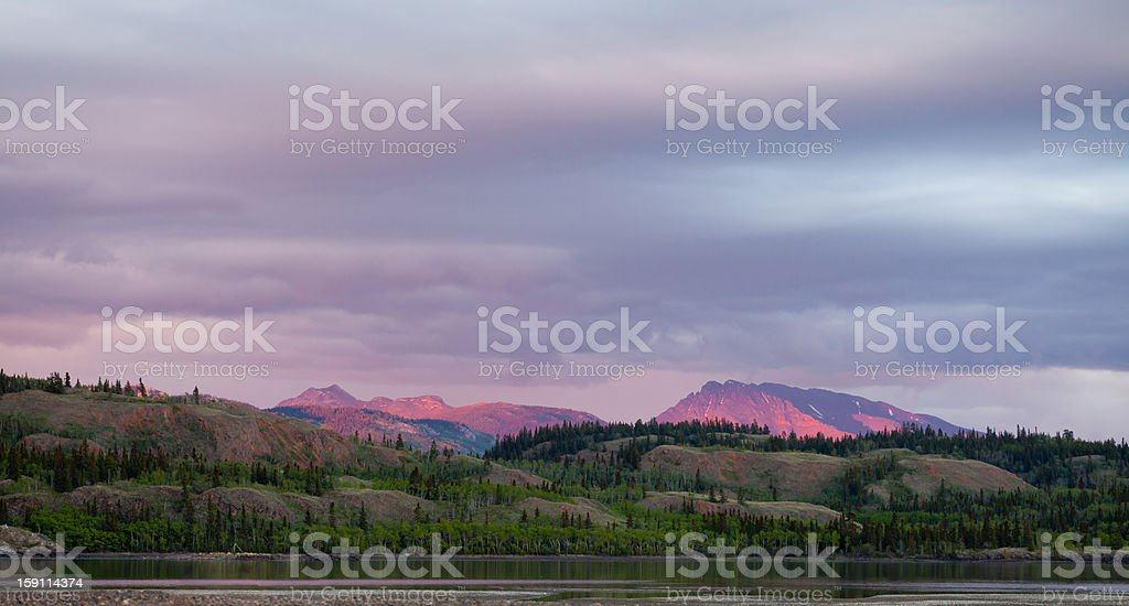 Distant Yukon mountains glowing in sunset light royalty-free stock photo