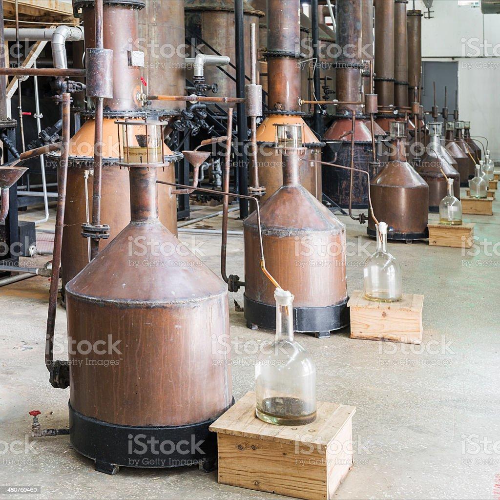 Distillation of rose oil stock photo