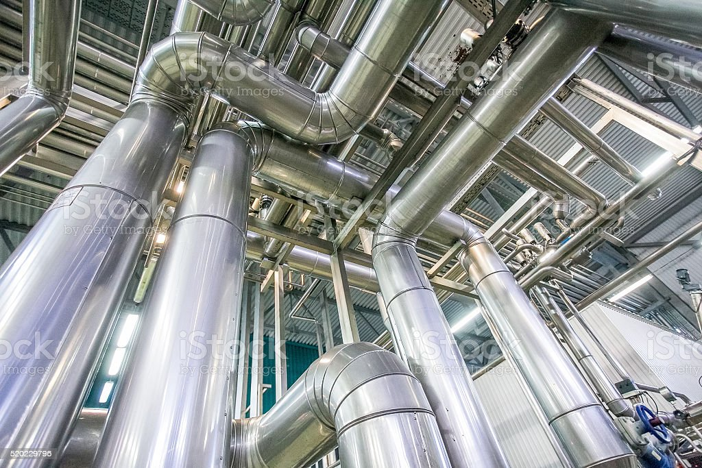 distillation process with many pipelines at the new bright factory stock photo