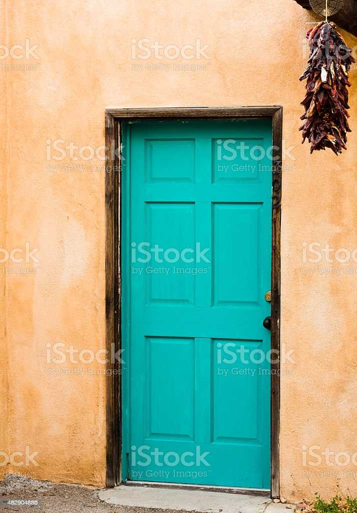 Distinctive blue door with hanging red peppers in Old Town stock photo