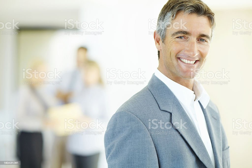 Distinguished executive supported by team royalty-free stock photo