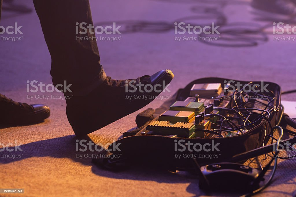 Distortion effect pedals under foot stock photo