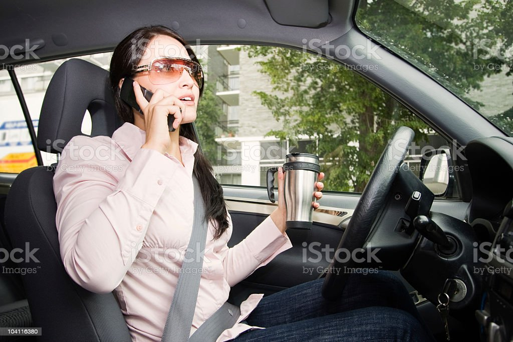 Distracted Driver Talking on her Cell Phone royalty-free stock photo