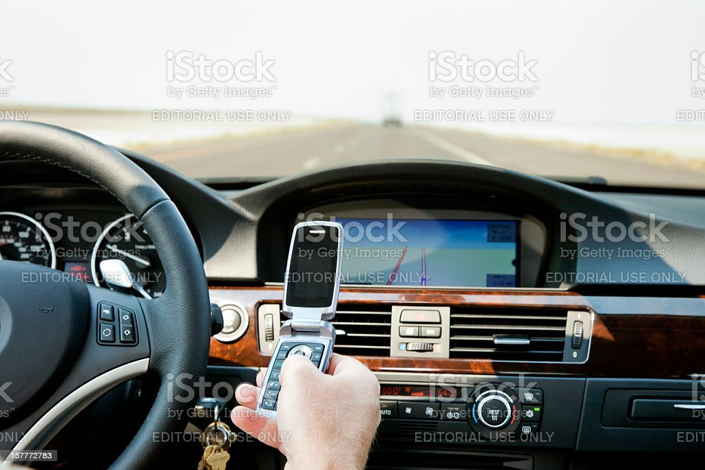 Distracted Driver with Mobile Phone, USA royalty-free stock photo