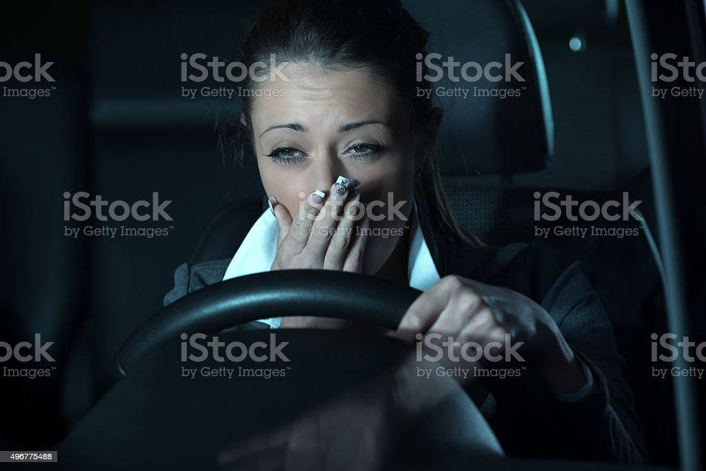 Distracted driving at night stock photo