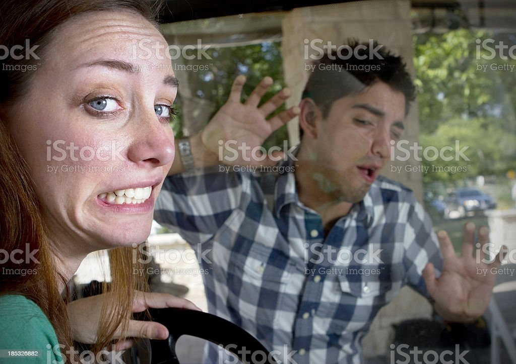 Distracted Female Driver Hits Young Man royalty-free stock photo