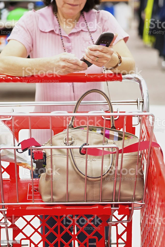 Distracted woman with an open handbag or pocketbook royalty-free stock photo