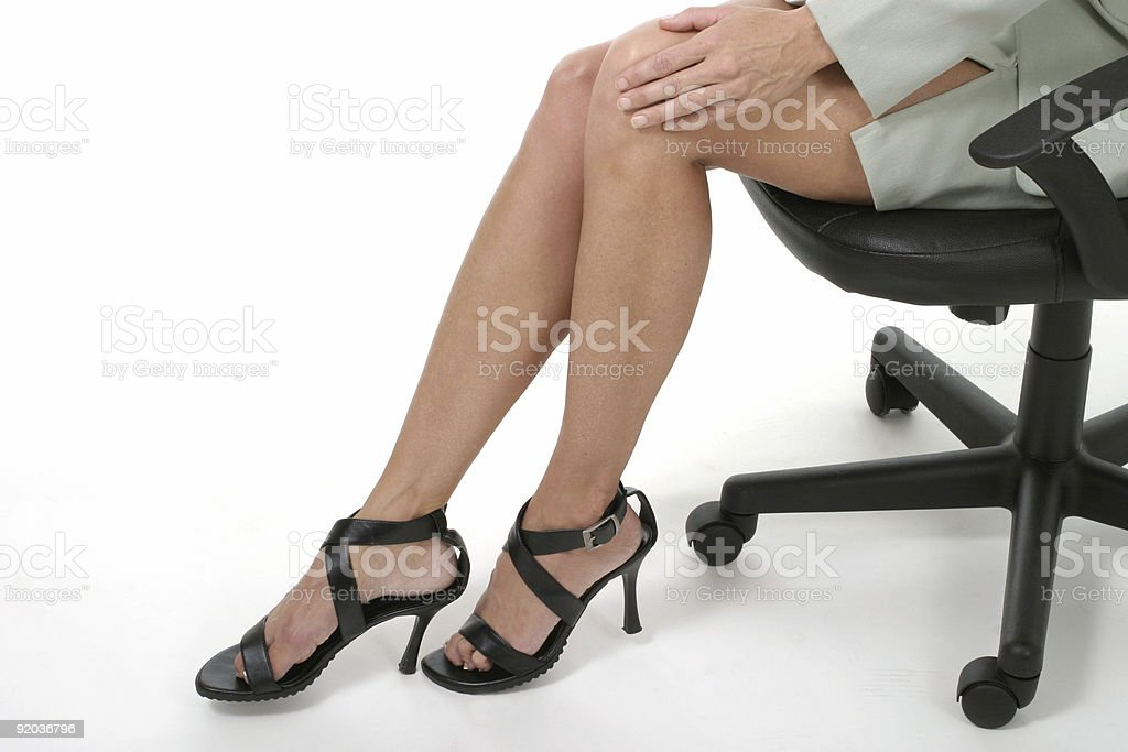 Distracting Woman's Legs in Business Office stock photo