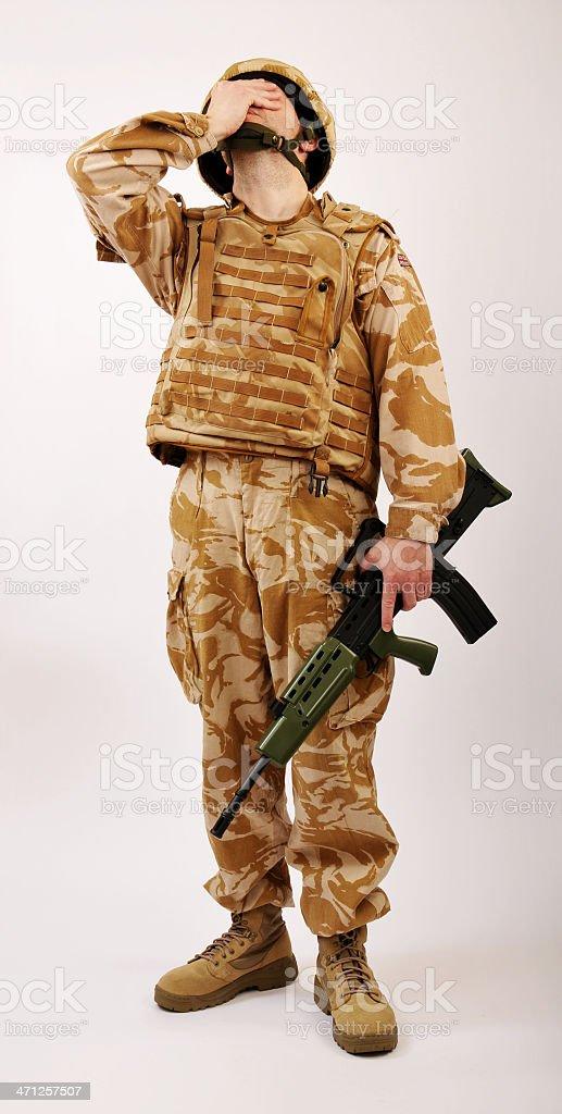 Distraught Desert soldier stock photo