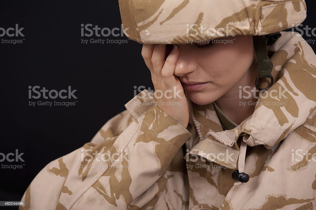 Distraught Female Soldier stock photo