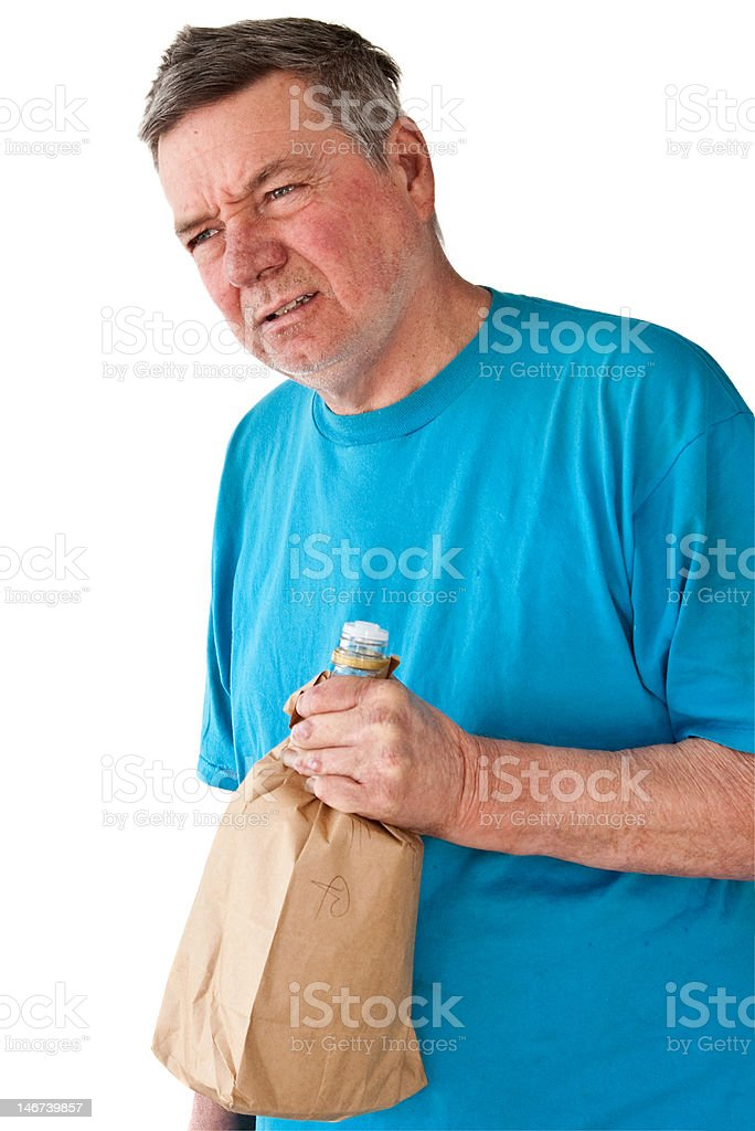 Distraught Mature Man with Bottle of Booze royalty-free stock photo