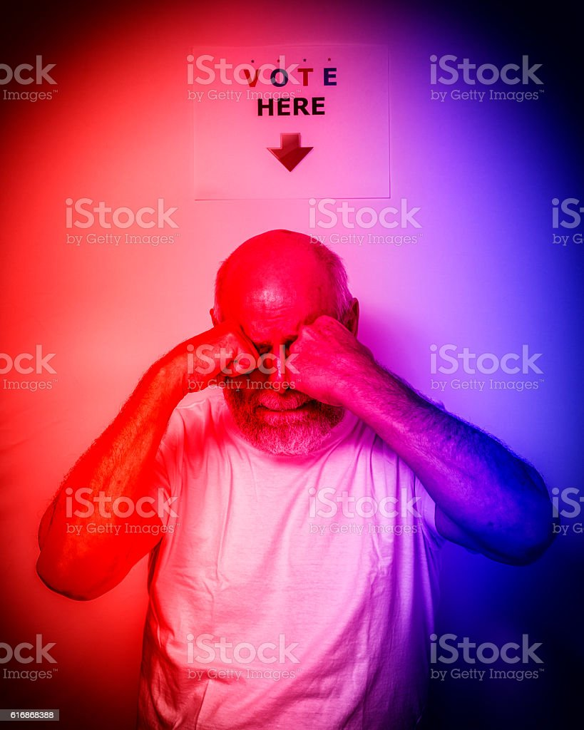 Distraught USA Independent Voter Senior Man Rubbing Eyes Crying stock photo