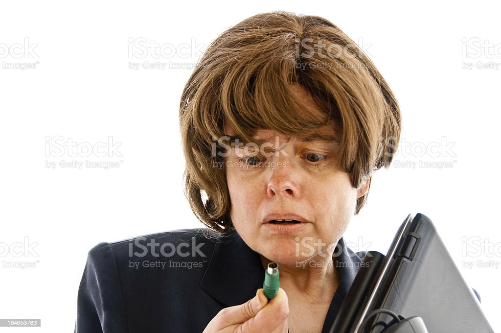 Distraught woman holds a PS2 mouse cable royalty-free stock photo