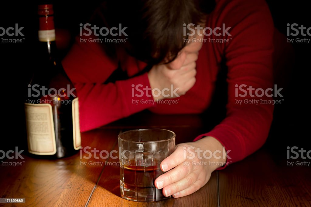 Distraught Woman with Whiskey stock photo