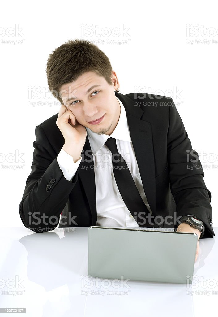 distraught young businessman with laptop royalty-free stock photo